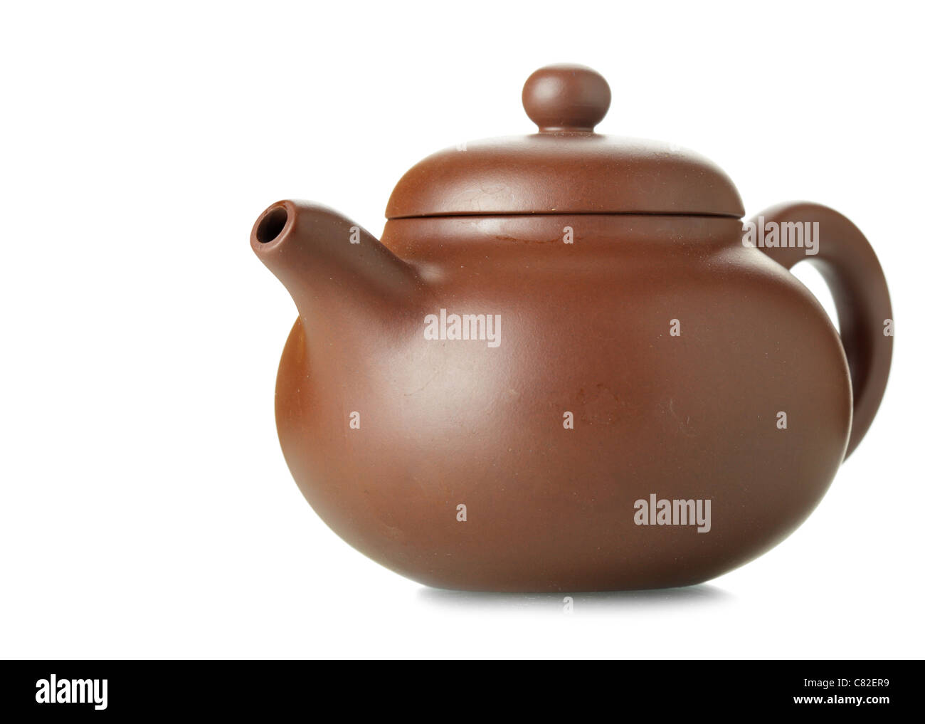 Chinese clay teapot isolated over the white background  - Stock Image