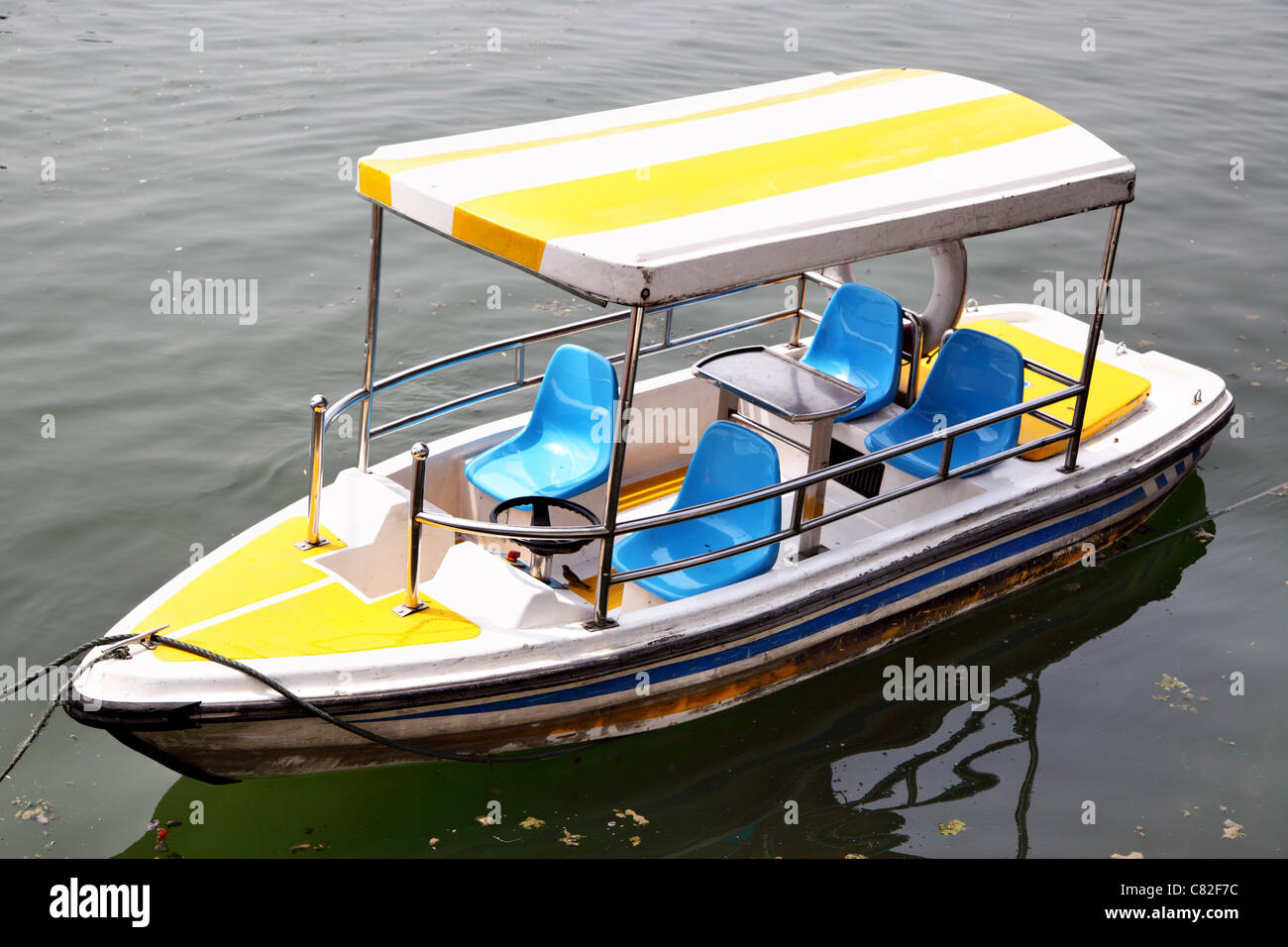 Electric traction recreation boat with awning close up - Stock Image