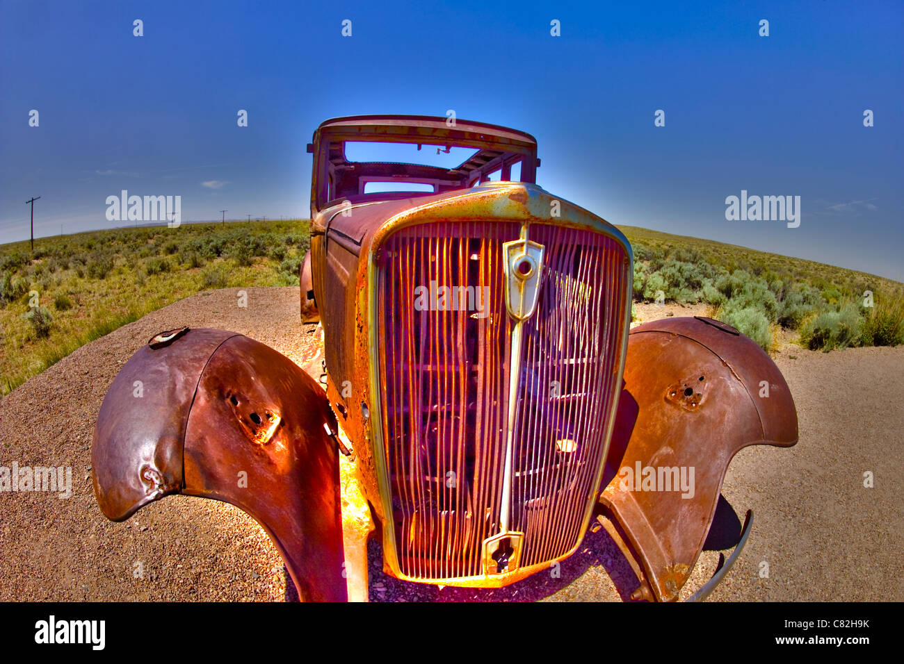 A 1932 Studebaker, servers as a monument to  those  who drove to California to escape the dust bowl of the 1930's - Stock Image