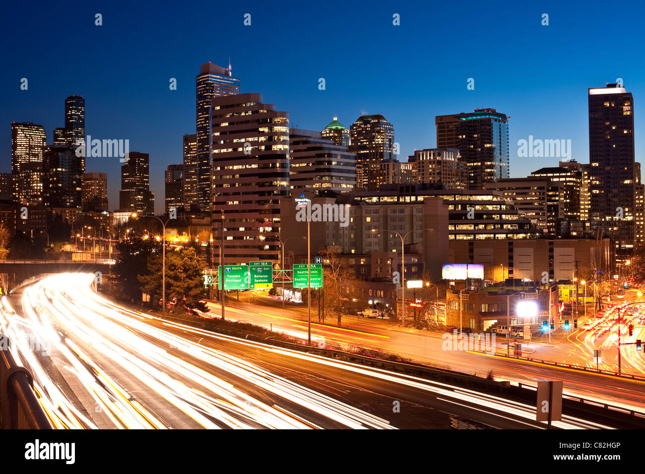 Seattle Downtown skyline with I-5 traffic with car light streaks - Stock Image