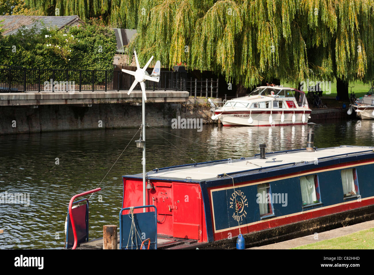 small wind turbine on a barge boat Stock Photo