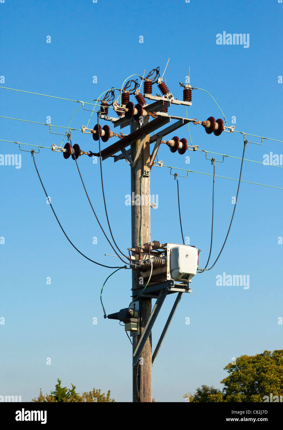 electricity supply pole, contactor relay, cables and insulators - Stock Image