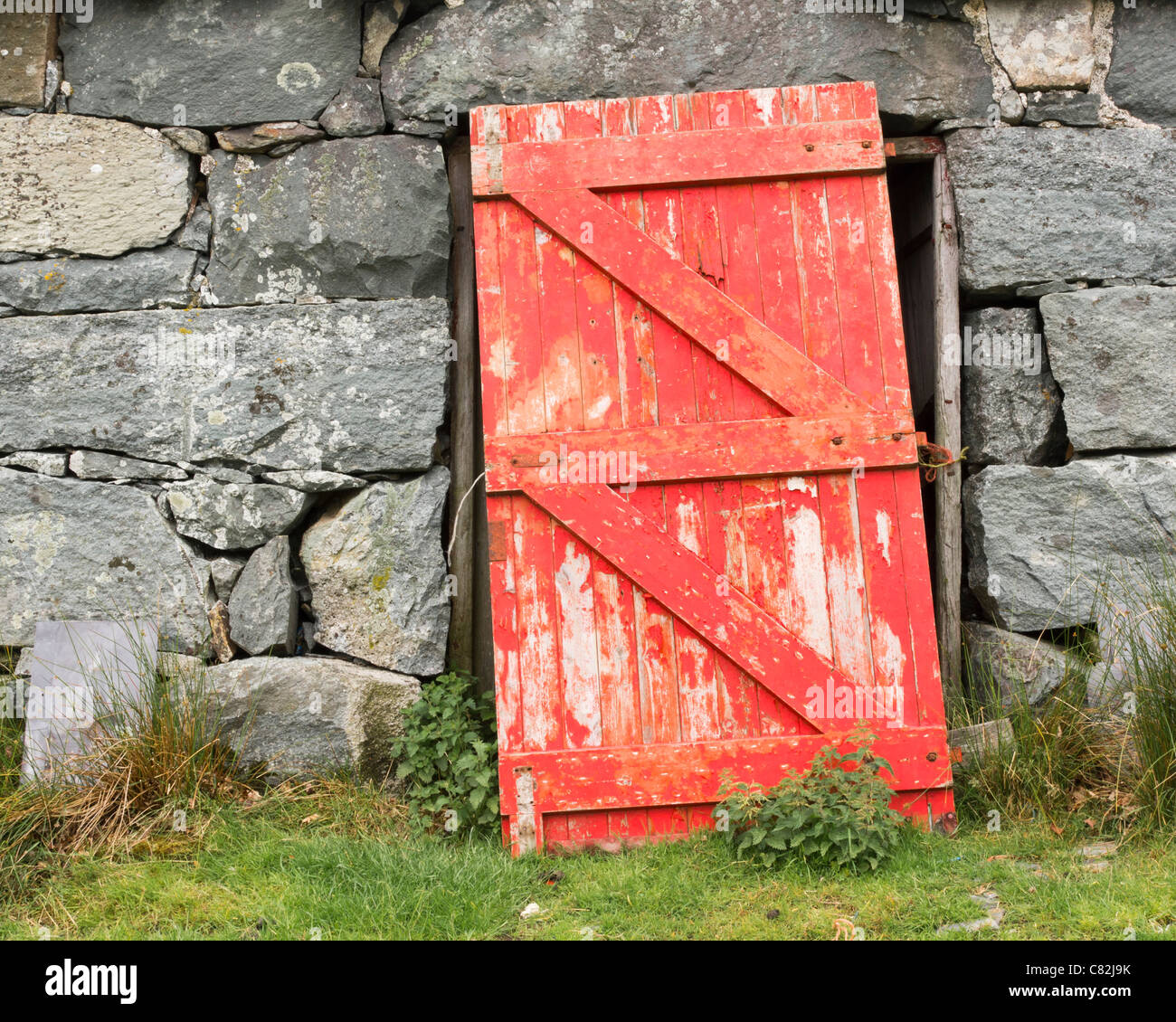 A Red Barn Door In A Grey Stone Wall Stock Photo 39396271 Alamy