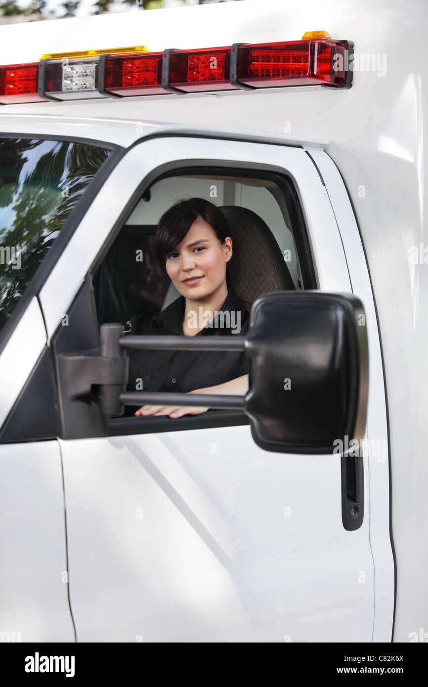 Portrait of a young EMT in an ambulance - Stock Image