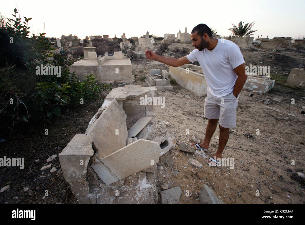Young Israeli Arab looking at a shattered tomb at the Muslim cemetery in Jaffa a mixed Jewish Arab neighbourhood - Stock Image