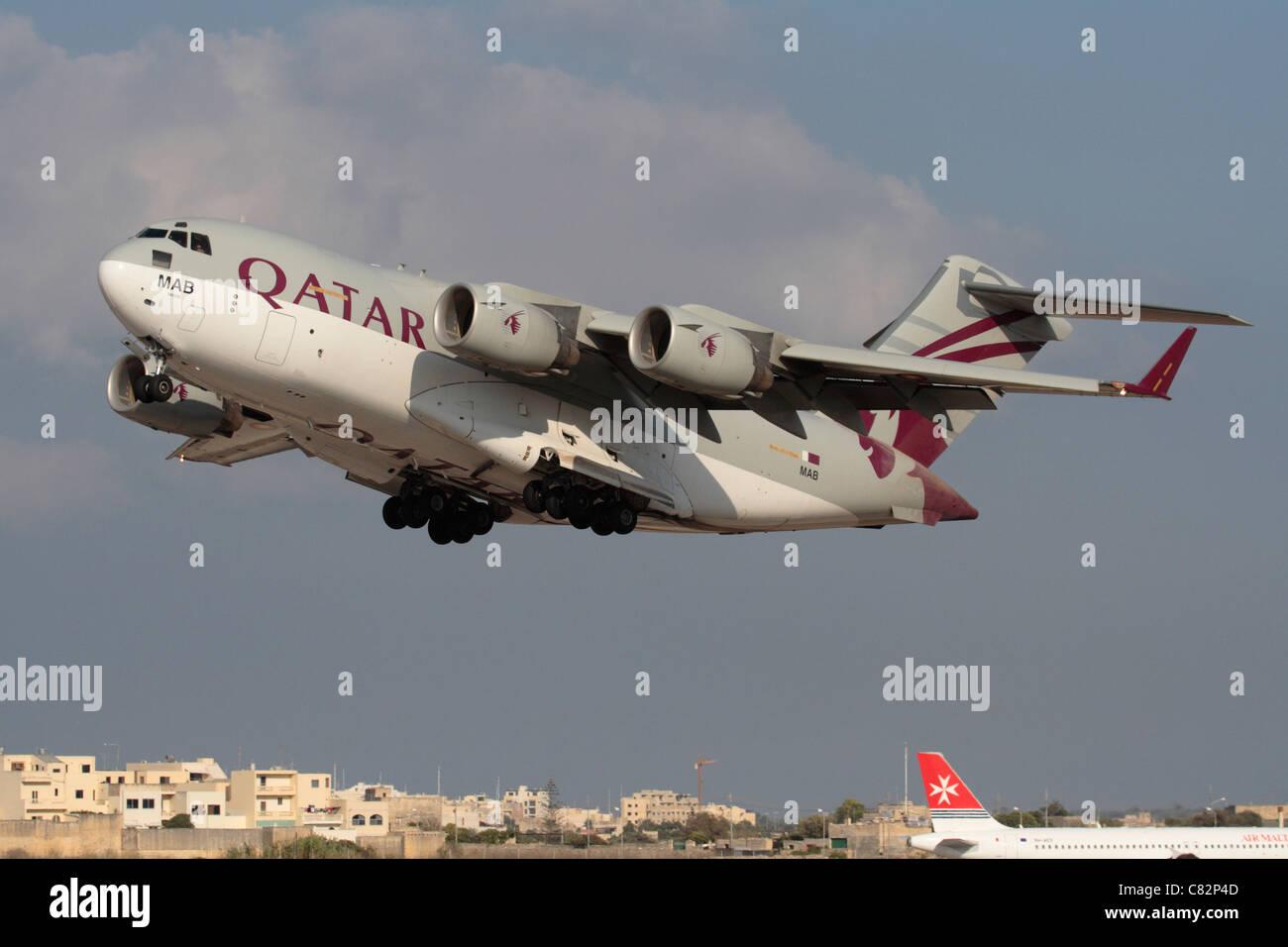 Qatar Emiri Air Force Boeing C-17A Globemaster III heavy military cargo jet taking off Stock Photo