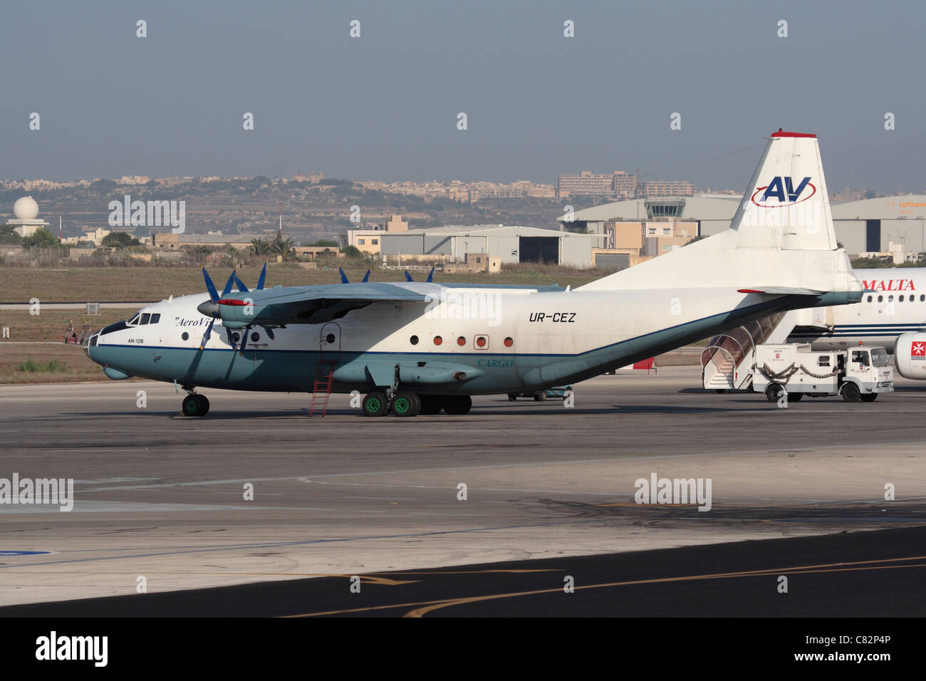 Aerovis Airlines Antonov An-12 cargo plane parked on airport ramp - Stock Image