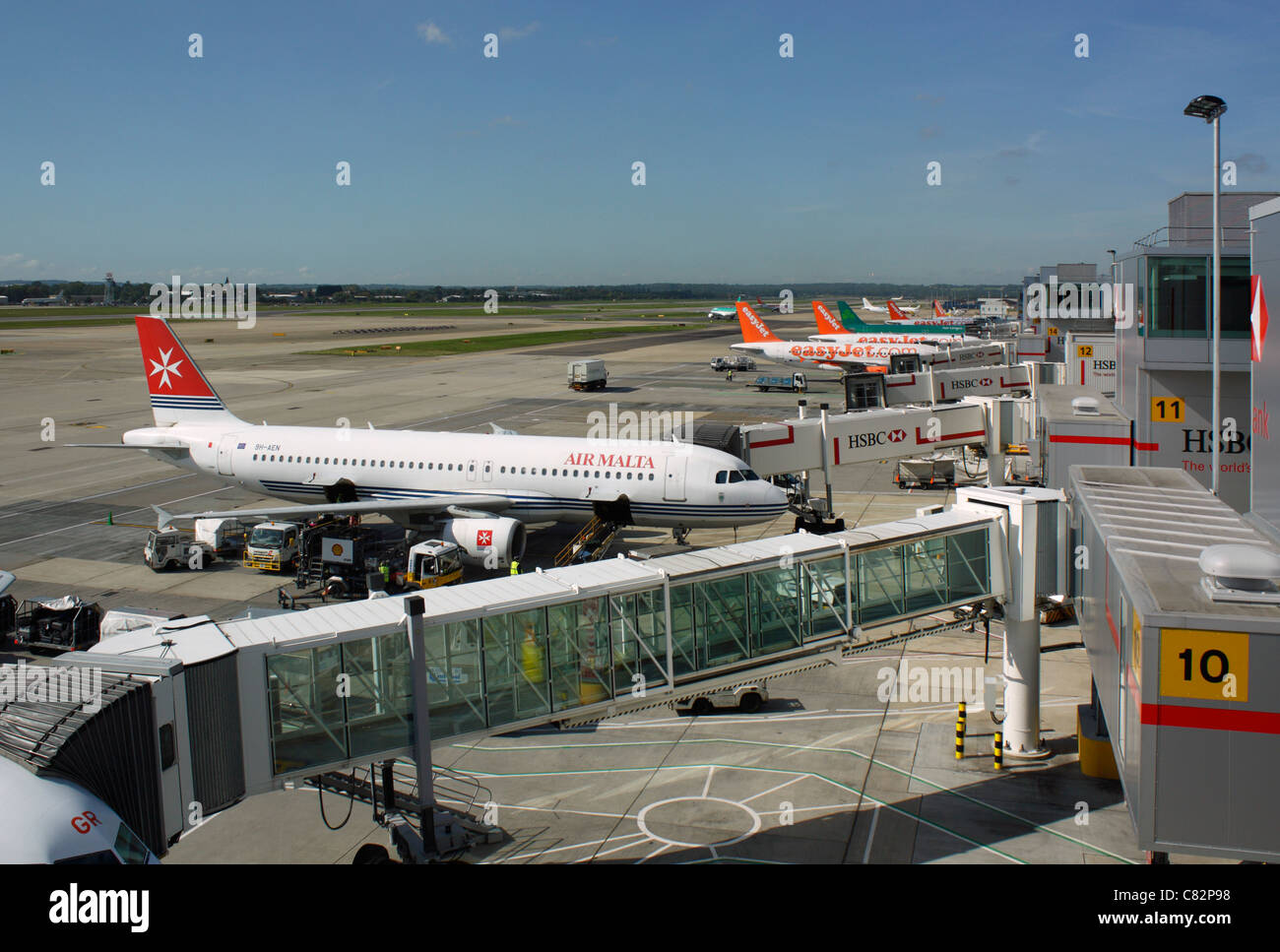 Aircraft on the ramp at Gatwick Airport - Stock Image