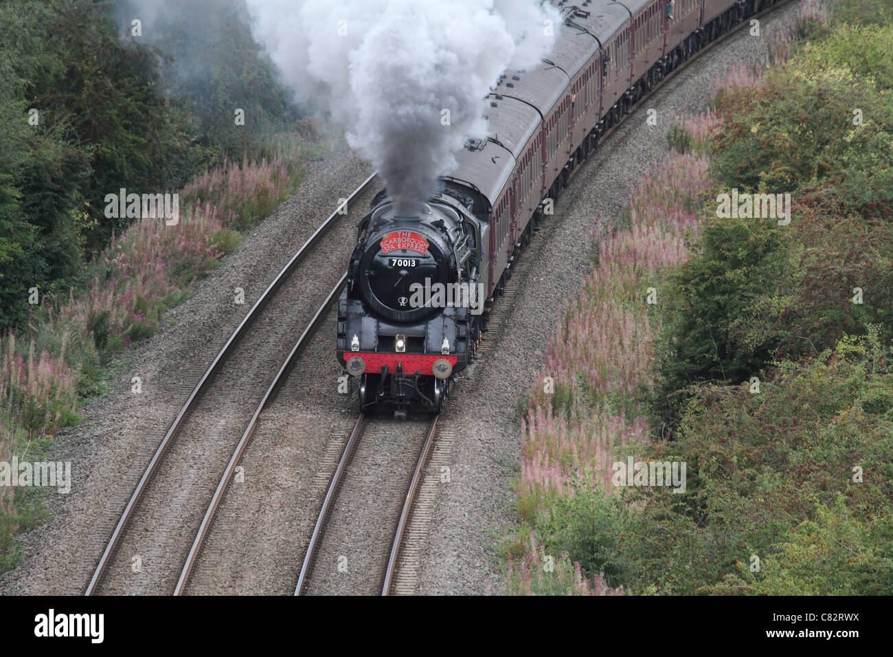 Scarborough express Steam locomotive  train with smoke running on tracks Stock Photo