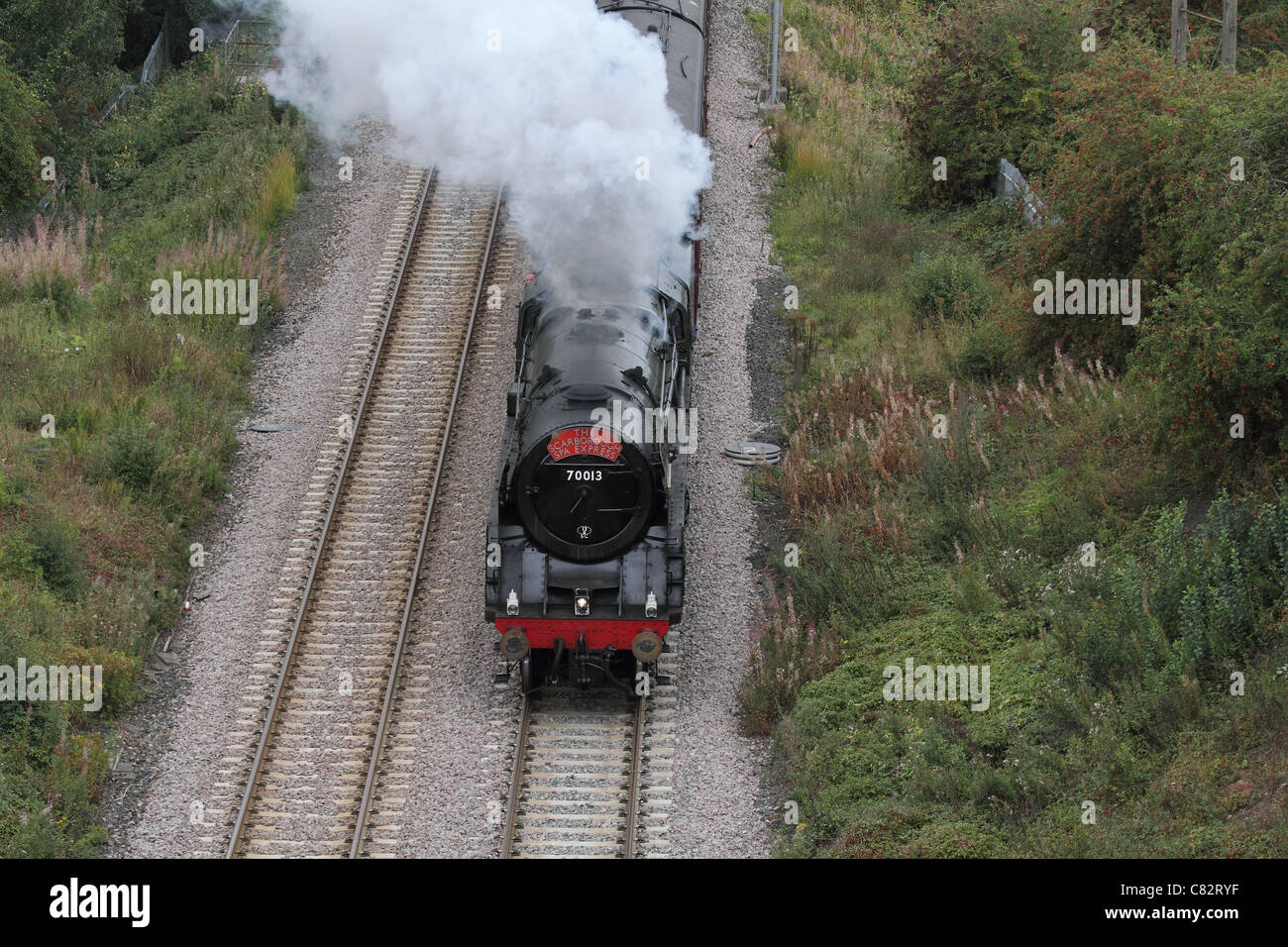 Scarborough express Steam locomotive  train with smoke running on tracks - Stock Image