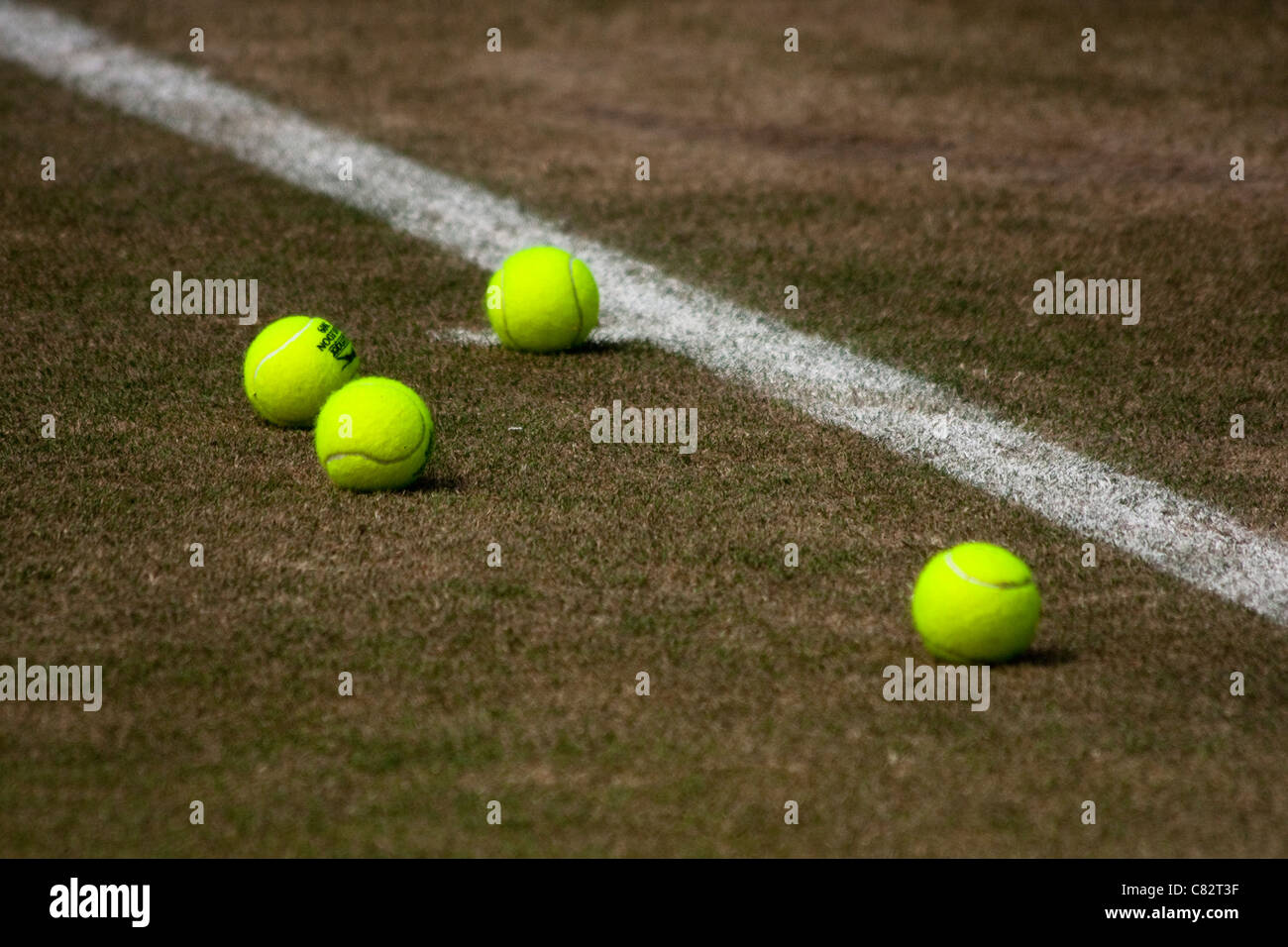 Wimbledon Tennis Balls on Court - Stock Image