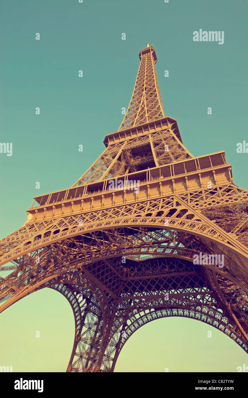 Eiffel tower photographed in vintage style from below - Stock Image