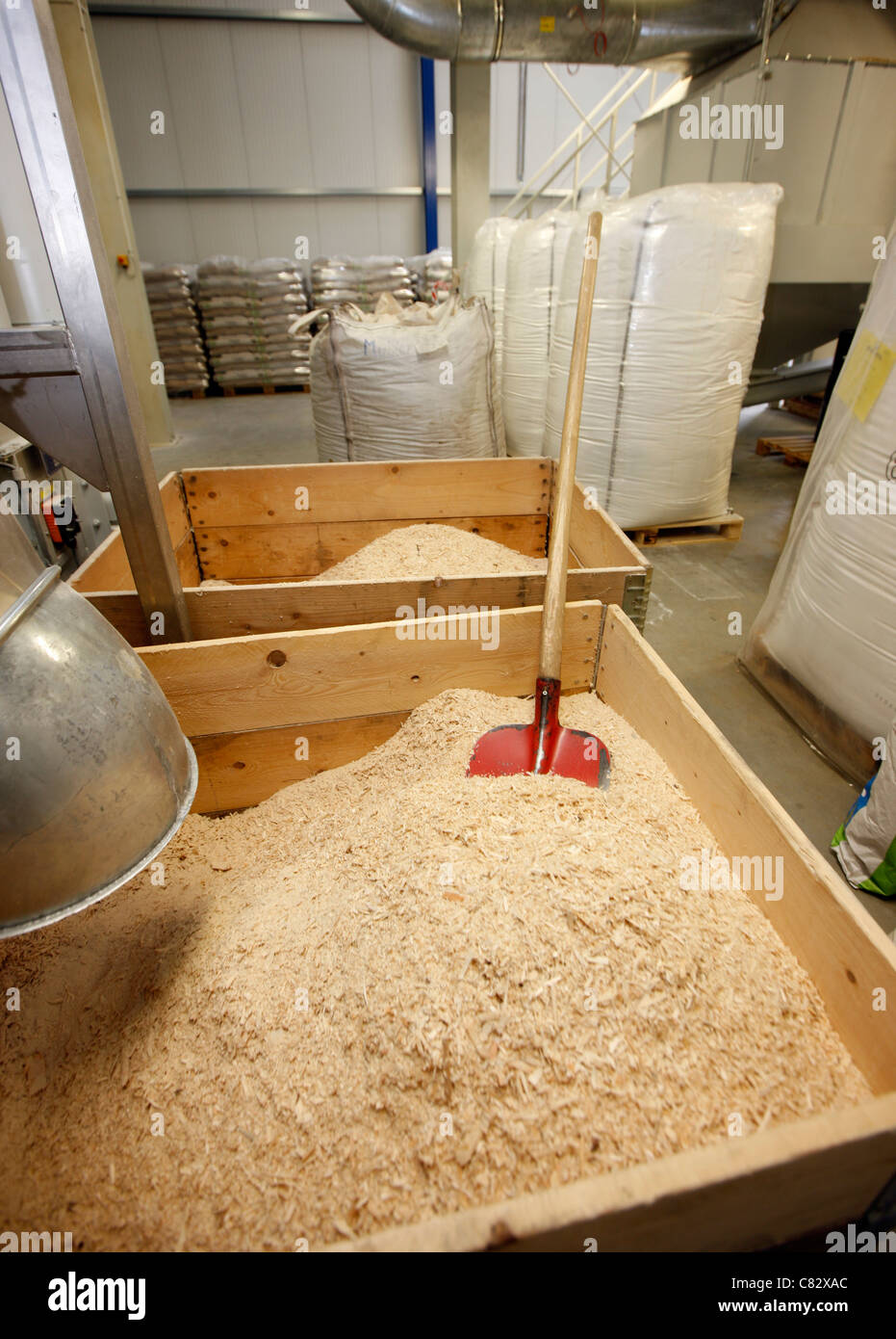 Production of wood pellets. A type of wood fuel. Sawdust is manufactured to pellets. Used in boilers of central Stock Photo