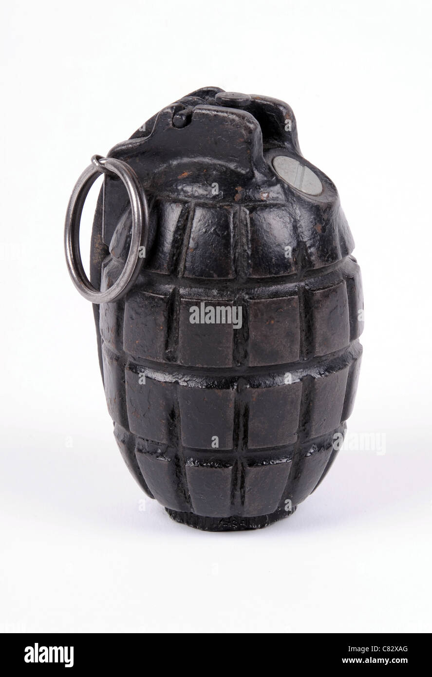 A Mills No.5 Mk.I defensive fragmentation hand grenade or 'Mills bomb' of WWI vintage. - Stock Image