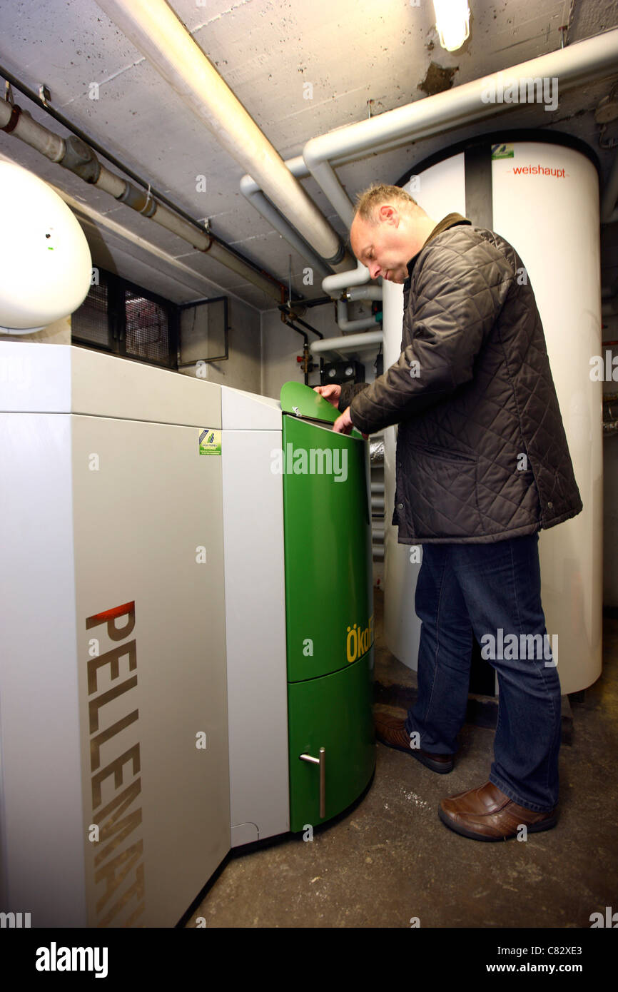Wood pellet boiler of a central heating system in a private home. - Stock Image