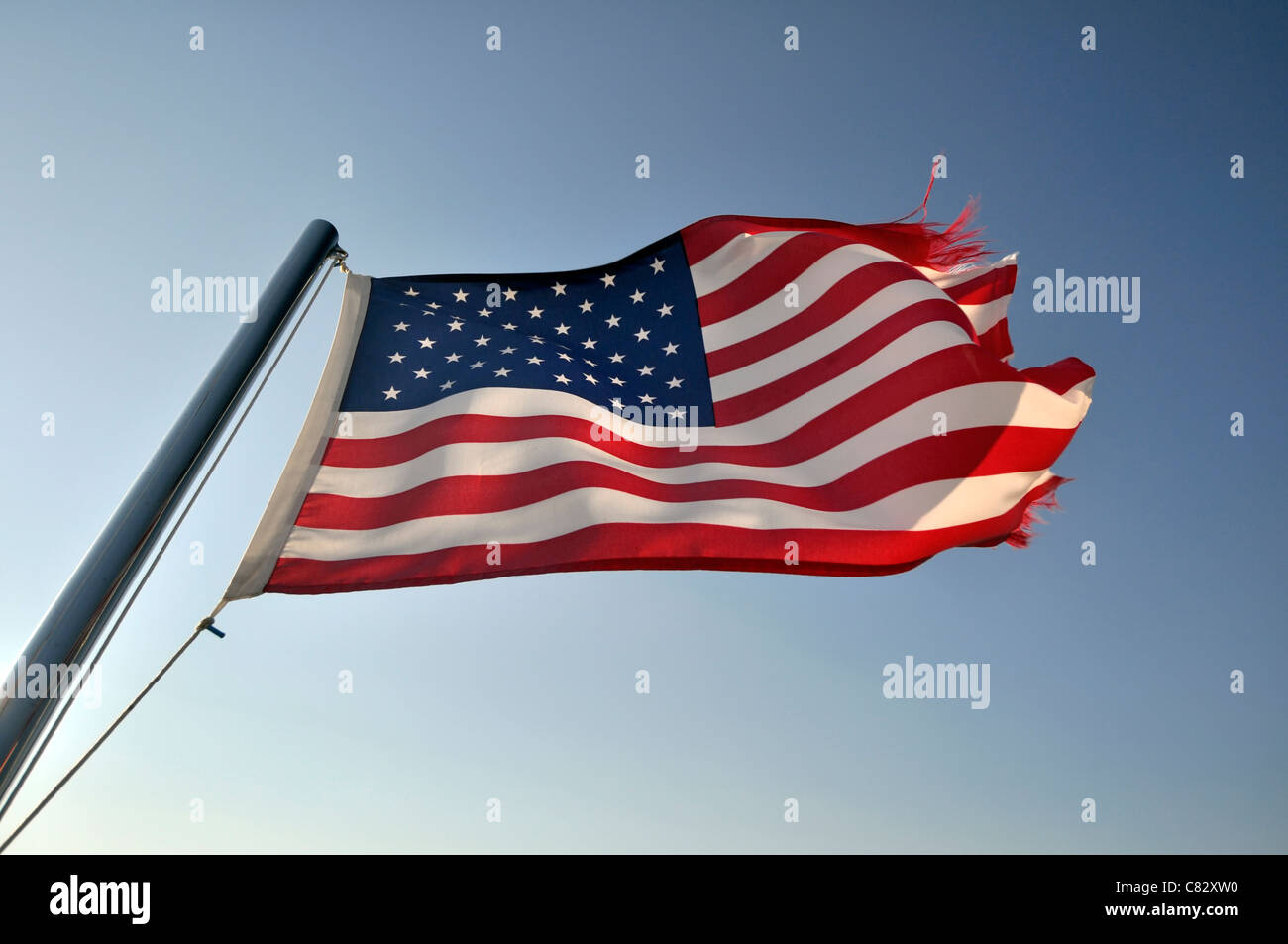ragged old American flag - Stock Image