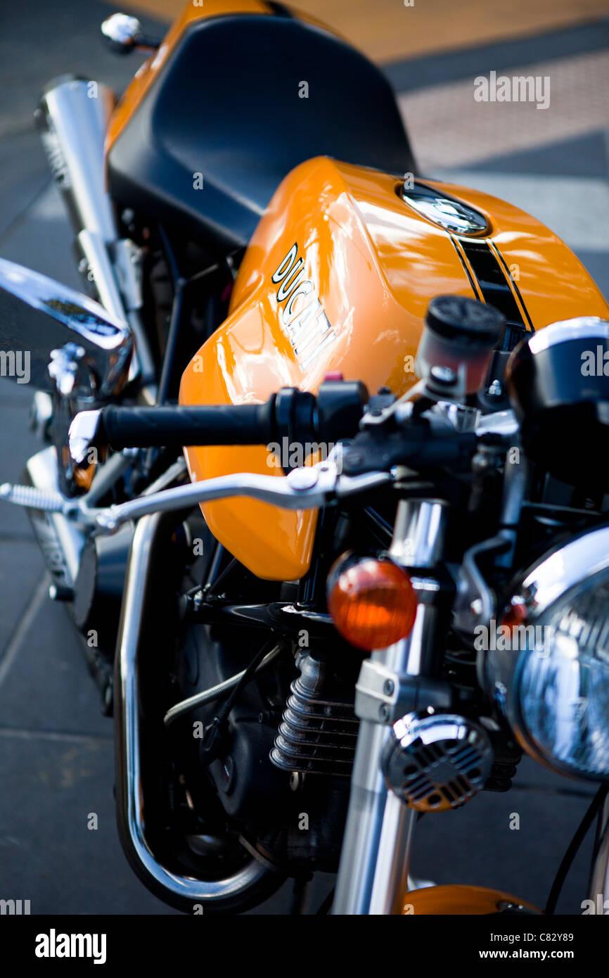 A flashy Ducati alongside the main drag at St. Kilda Beach, Melbourne, Australia. - Stock Image