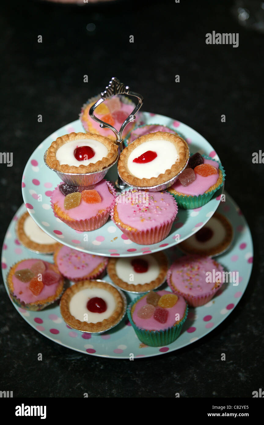 Cake stand of fancy cakes - Stock Image