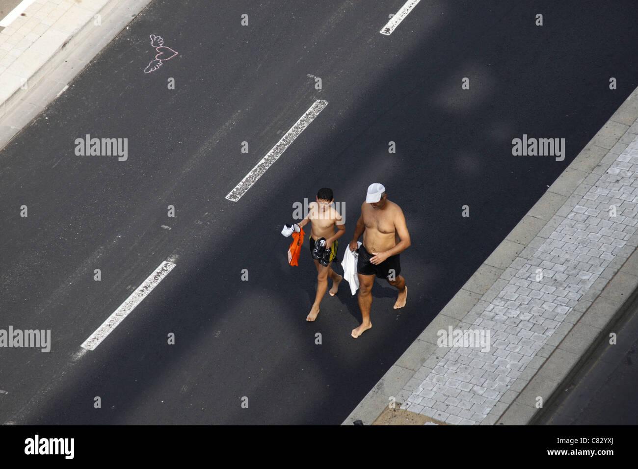 Local residents walking in empty motorway Tel Aviv Israel - Stock Image