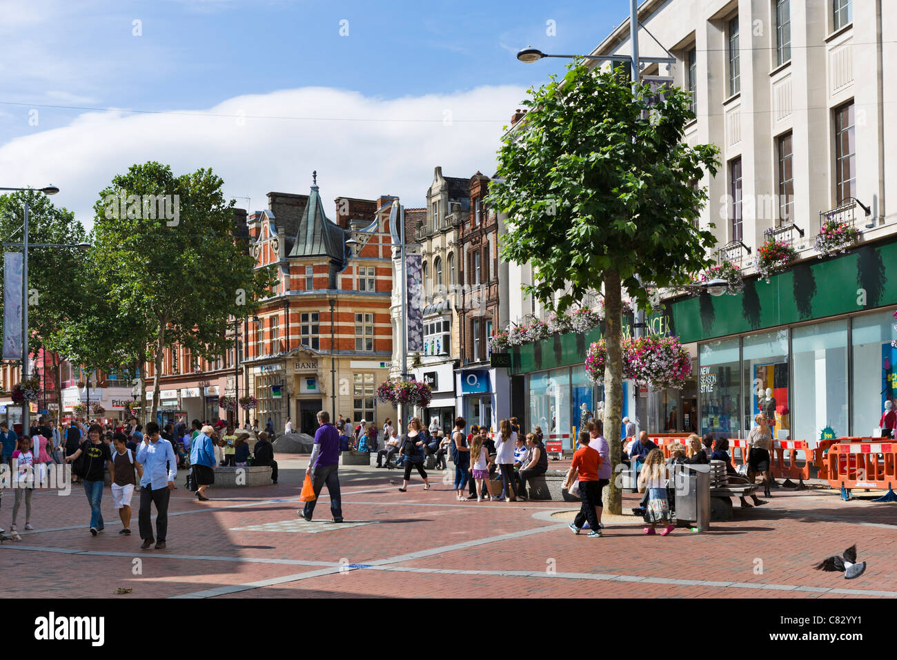 Shops on Broad Street (the main shopping area) in the city centre, Reading, Berkshire, England, UK - Stock Image