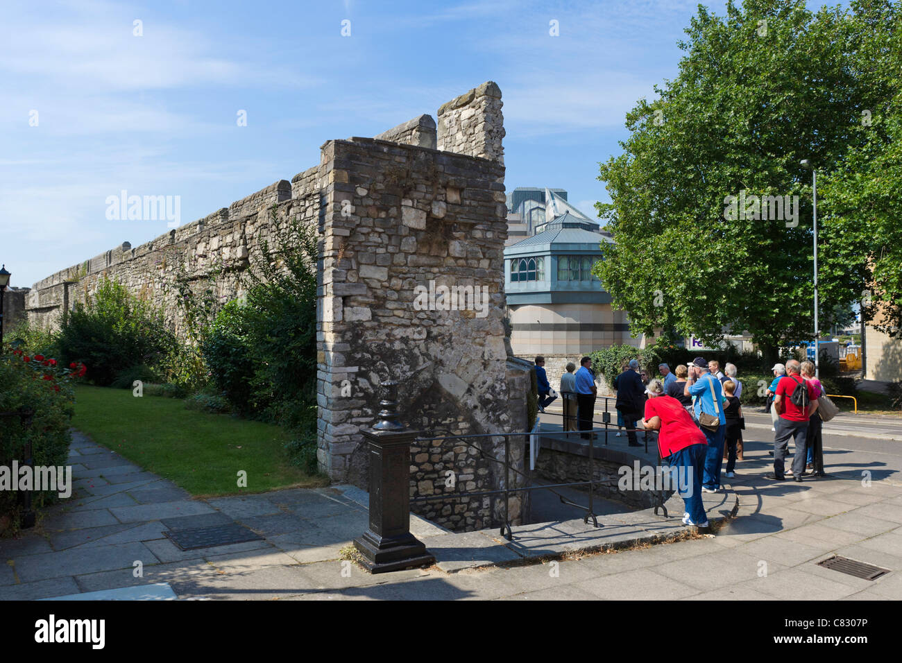 Visitors on a tour of the Old City Walls near Castle Square, Southampton, Hampshire, England, UK - Stock Image