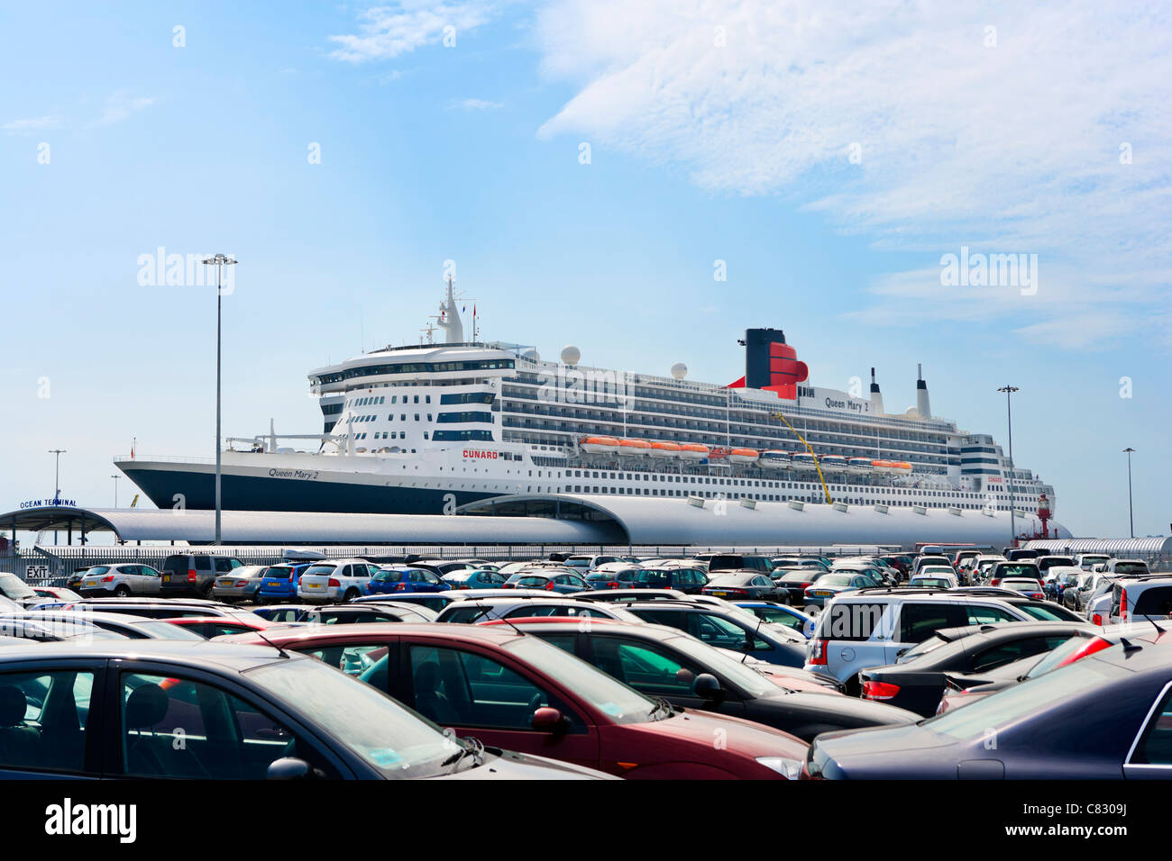 The cruise liner Queen Mary 2 viewed across a car park at Ocean Terminal, Southampton Docks, Southampton, Hampshire, - Stock Image