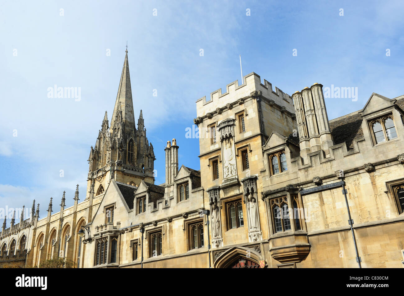University Church spire of St Mary the Virgin on the High Street and All Souls College Oxford England Uk - Stock Image