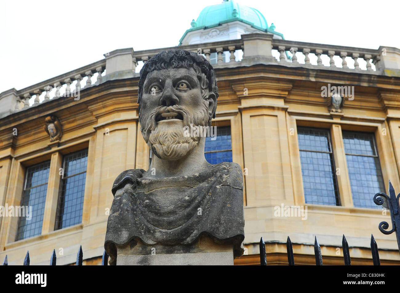 One of the busts of the Emperor's Heads outside the Sheldonian Theatre in Oxford Stock Photo