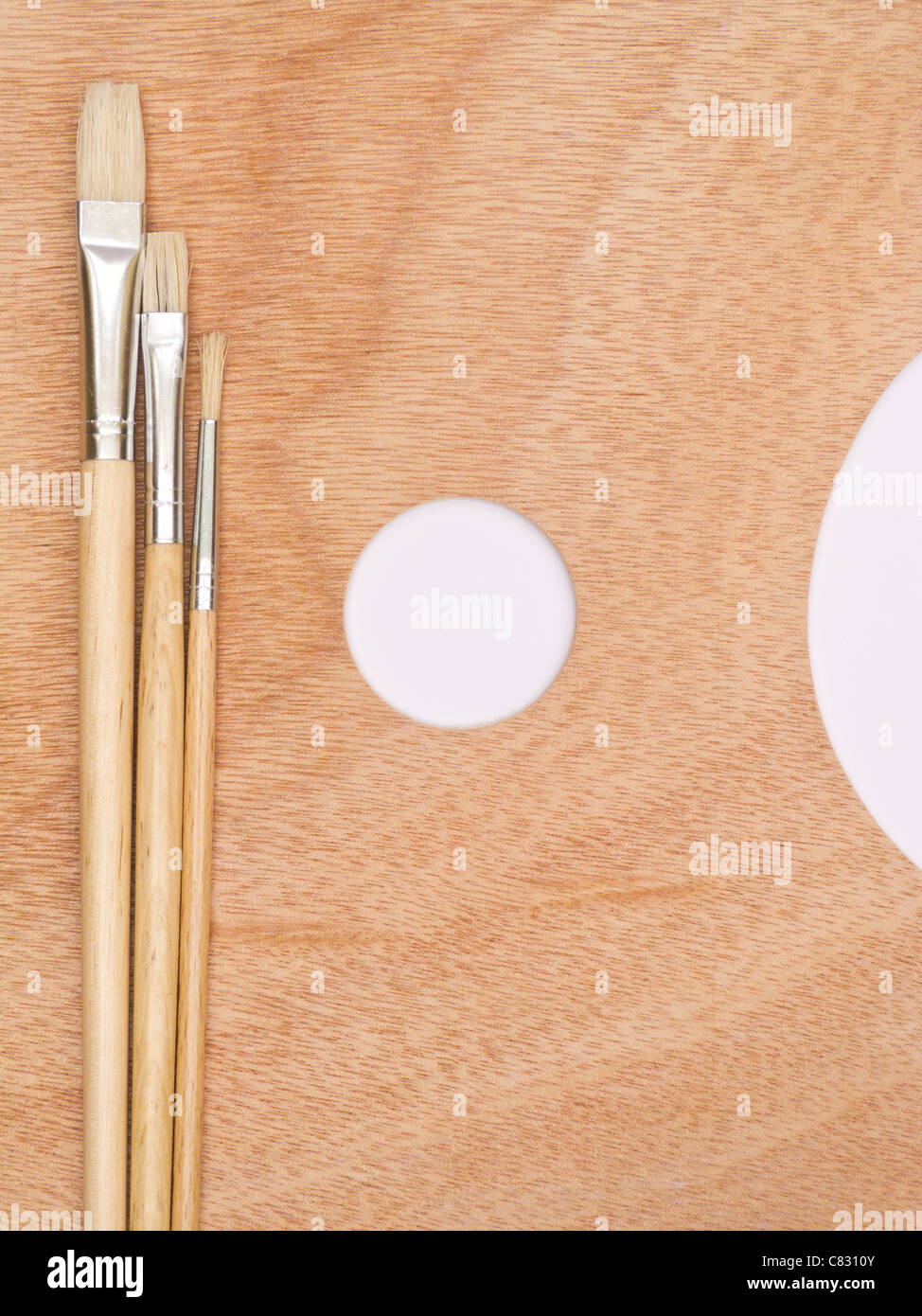 Paint brush on palette - Stock Image