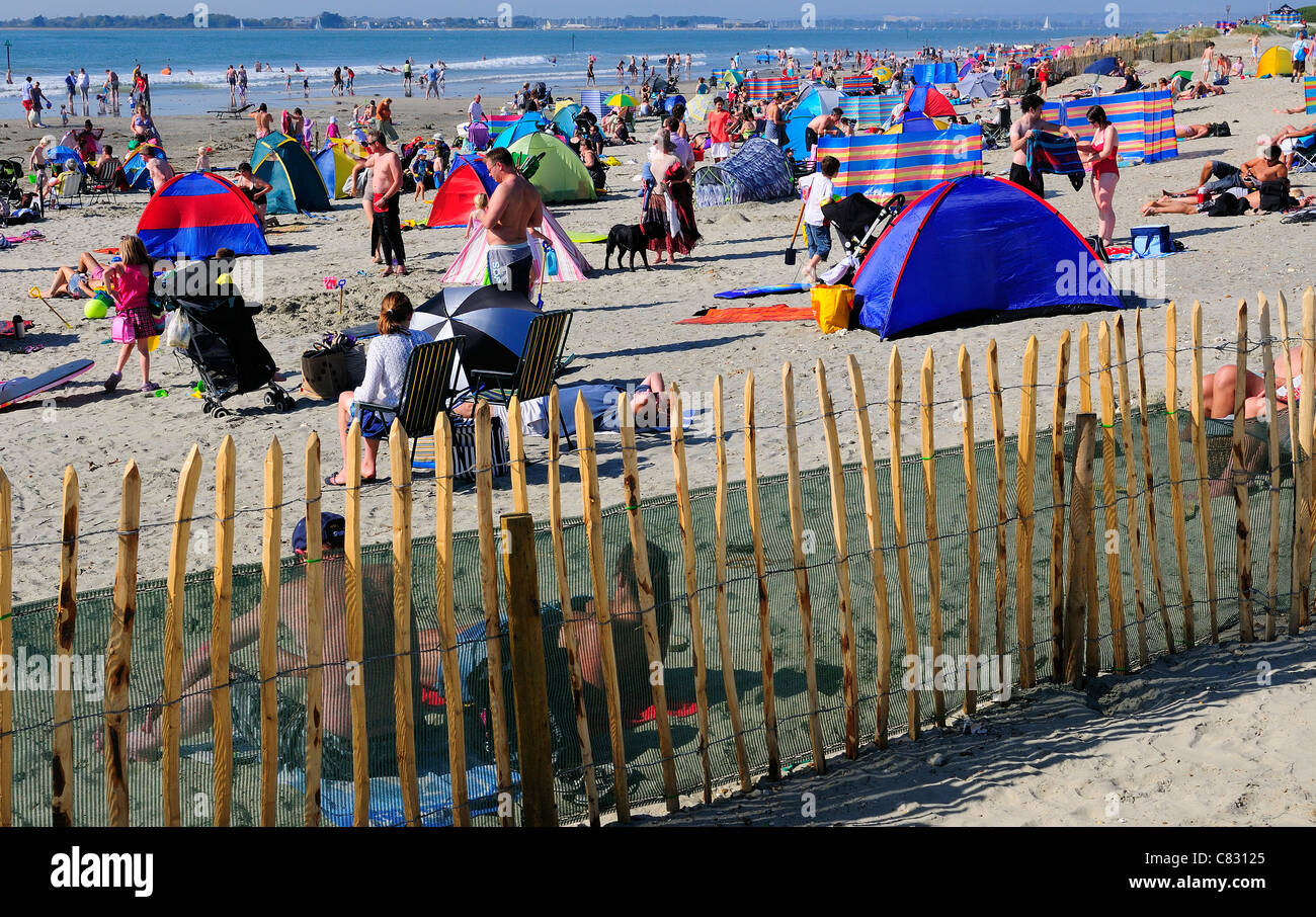 Couples and people relaxing on West Wittering's beach on 'the hottest  day of the year'-surprisingly on Autumns - Stock Image