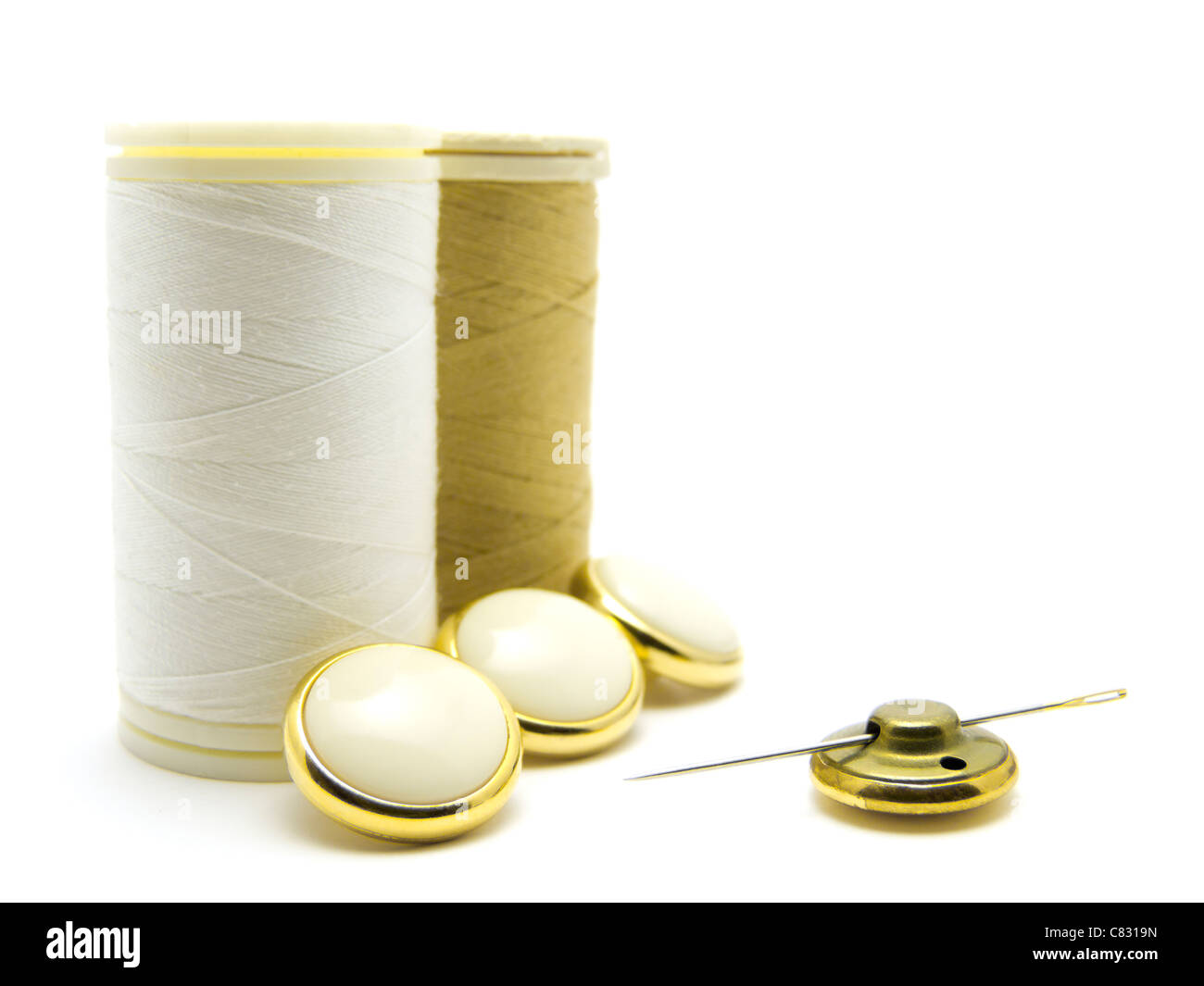 Sewing Items White Gold - Stock Image