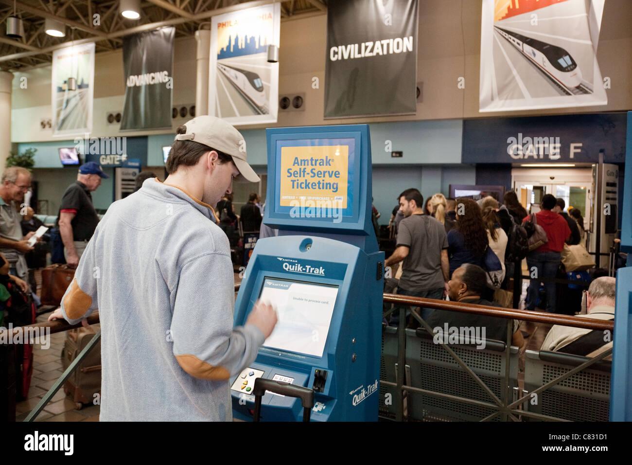 A man buying a rail ticket for an Amtrak train, Union Station, Washington DC USA - Stock Image