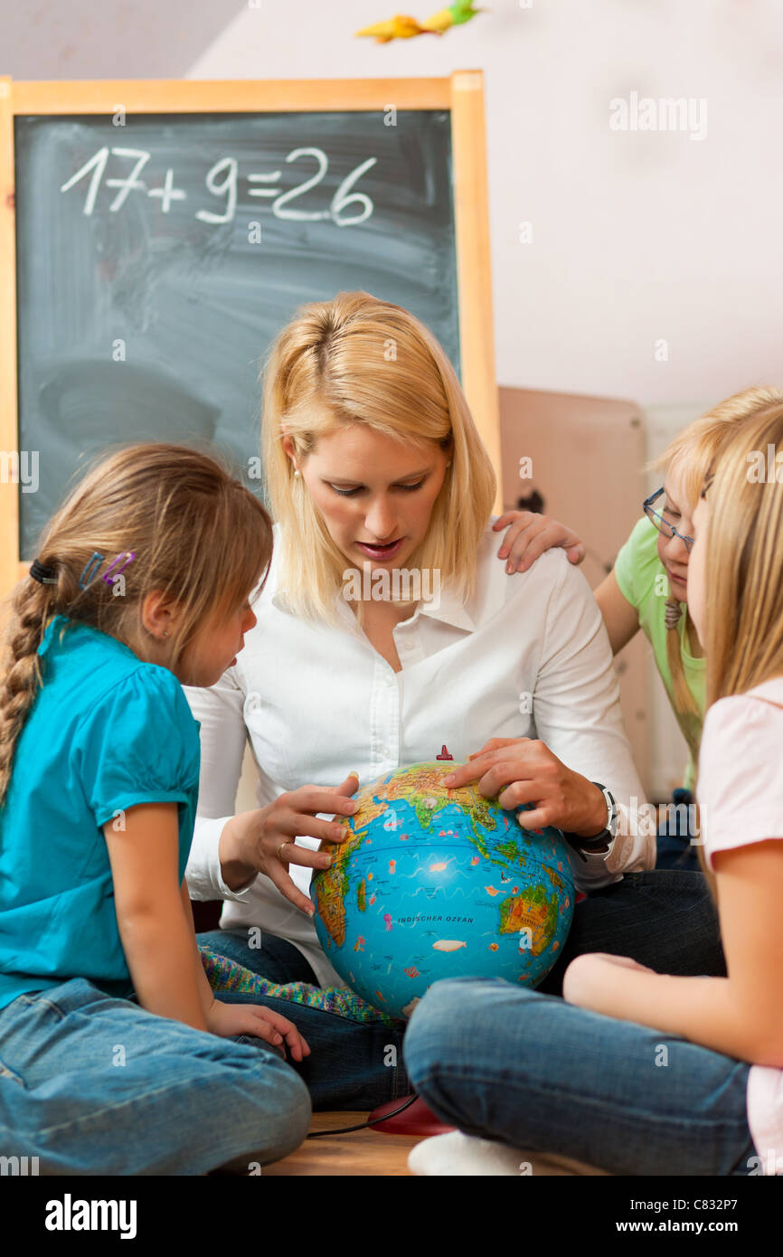 Family affairs - mother explaining the world to her children; presumably she is a teacher - Stock Image