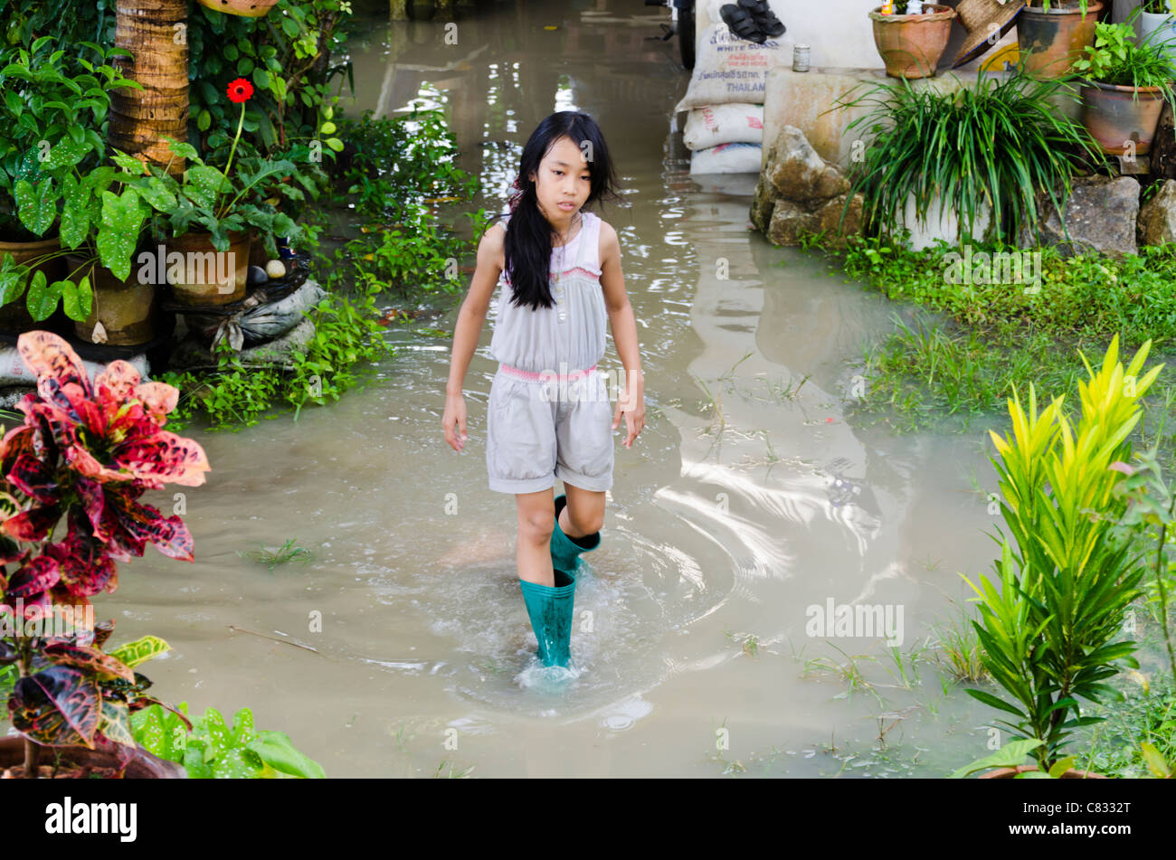 A Cute 9 Year Old Asian Girl With Long Black Hair Wearing Boots