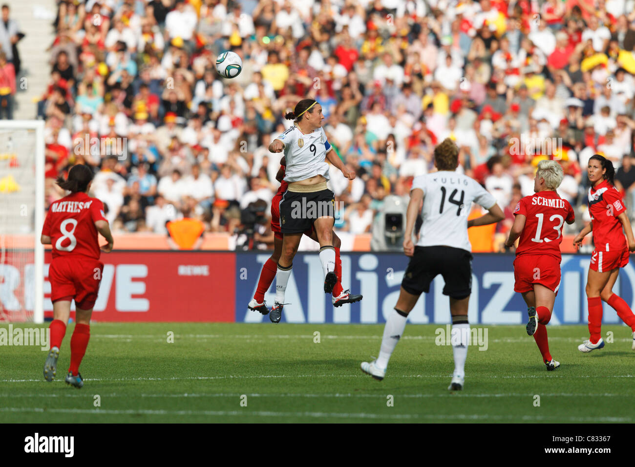 Germany team captain Birgit Prinz (9) heads the ball during the opening match of the 2011 Women's World Cup - Stock Image