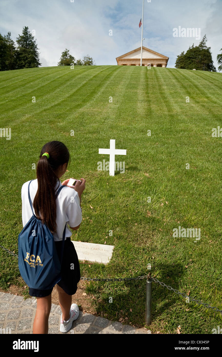 A schoolgirl taking a photo of the grave of  Robert F Kennedy, Arlington Cemetery, Washington DC USA - Stock Image