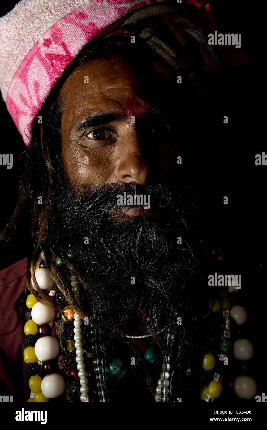 An Indian Sadhu in a colorful religious mela. - Stock Image