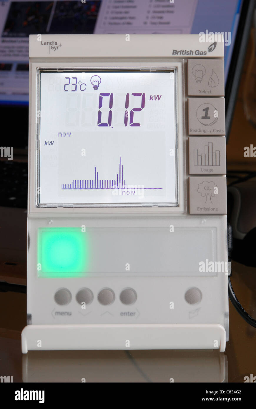 A domestic British Gas Smart Meter in 'electricity' mode, with green light indicating low energy consumption. - Stock Image