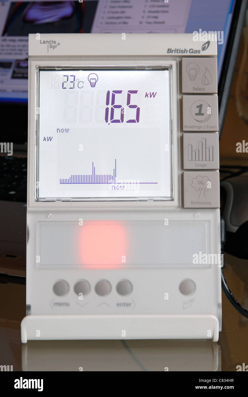 A domestic British Gas Smart Meter in 'electricity' mode, with amber light indicating average energy consumption. - Stock Image
