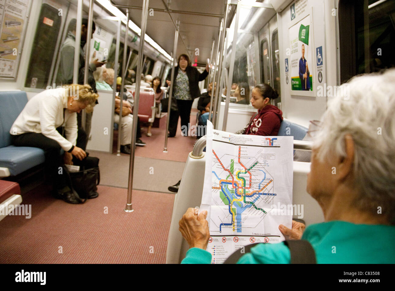 Metro Train Dc Map.An Elderly Lady Reading A Map Of The Metro Subway Rail System Stock
