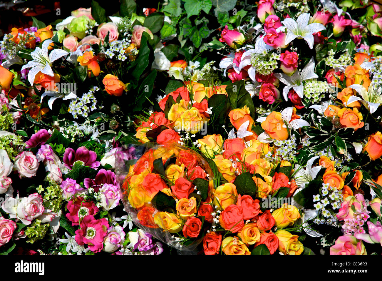 Lots of different flowers on market with some arranged in a bouquet lots of different flowers on market with some arranged in a bouquet izmirmasajfo Gallery