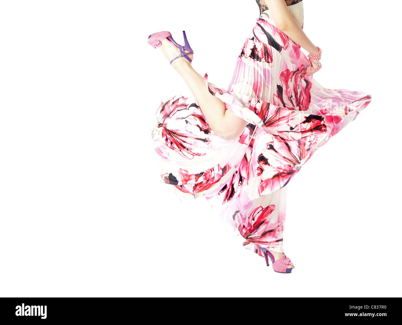 Body part of the woman dancing in stylish pink dress - Stock Image