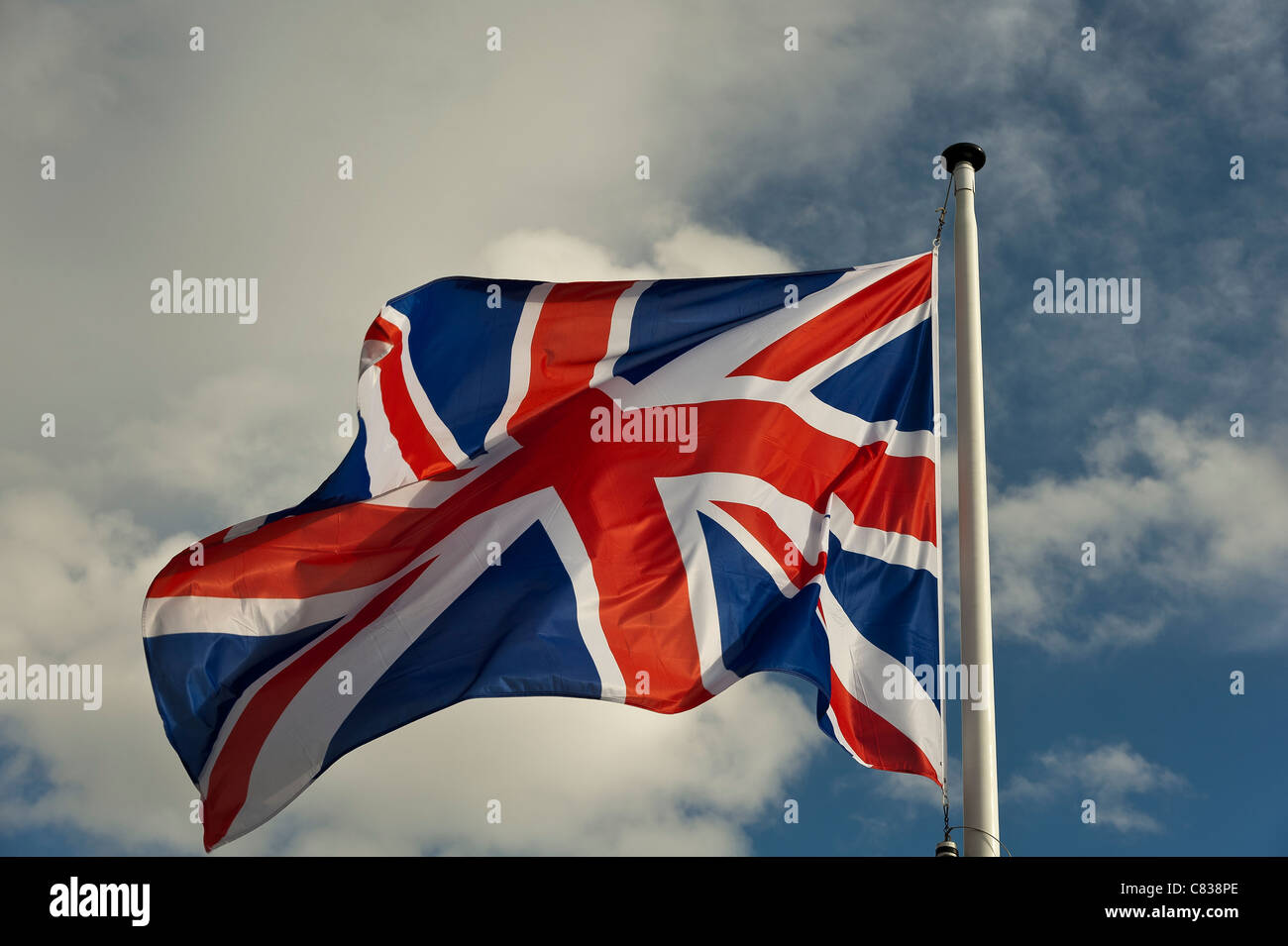 Union flag flying in the wind - Stock Image