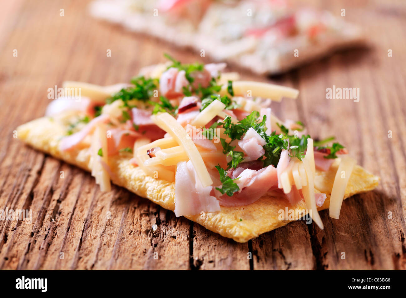 Crispbread with ham and cheese - closeup - Stock Image