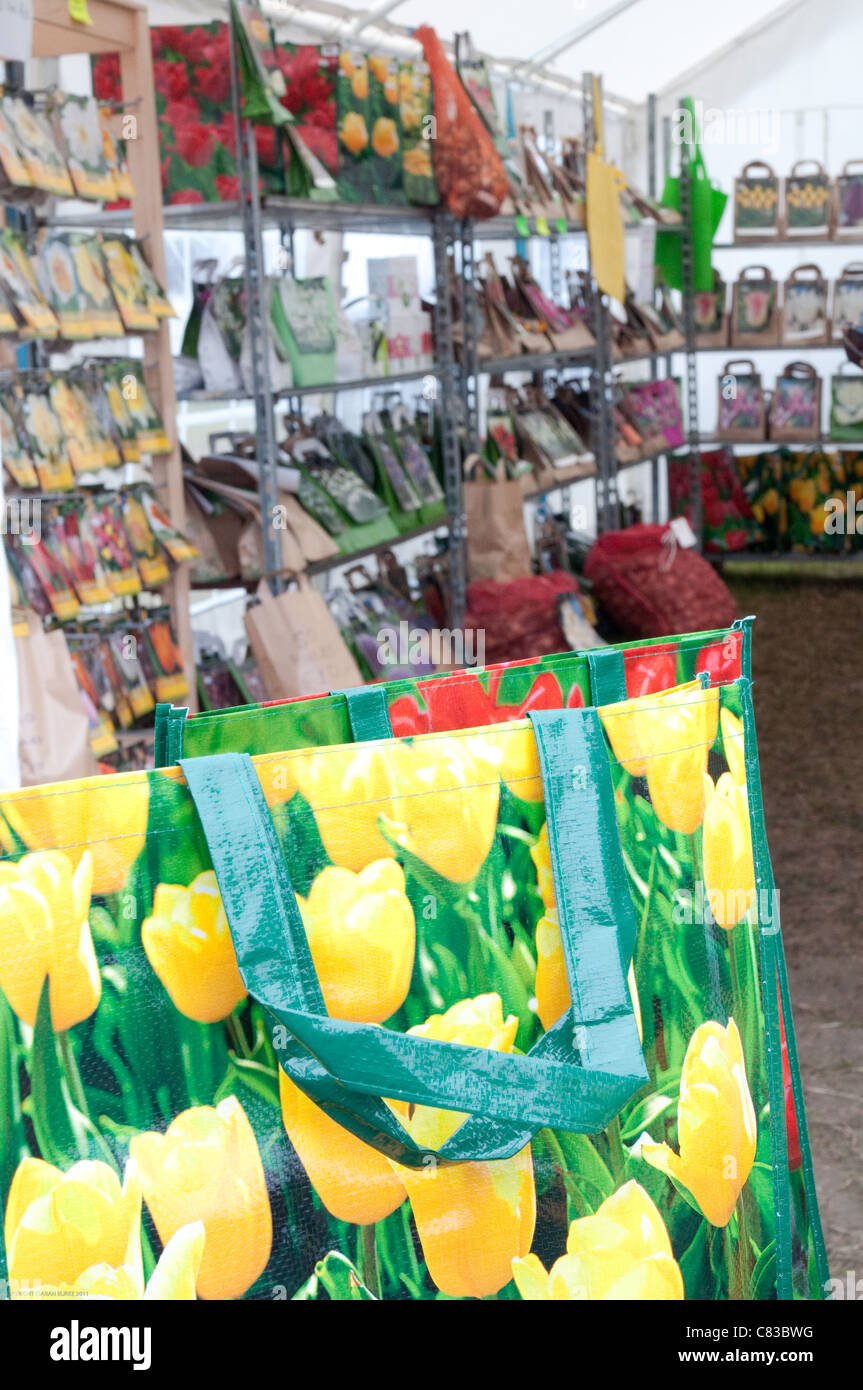 COLOUFUL FLOWER BULB BAGS ON BEECHILL BULBS STAND Stock Photo