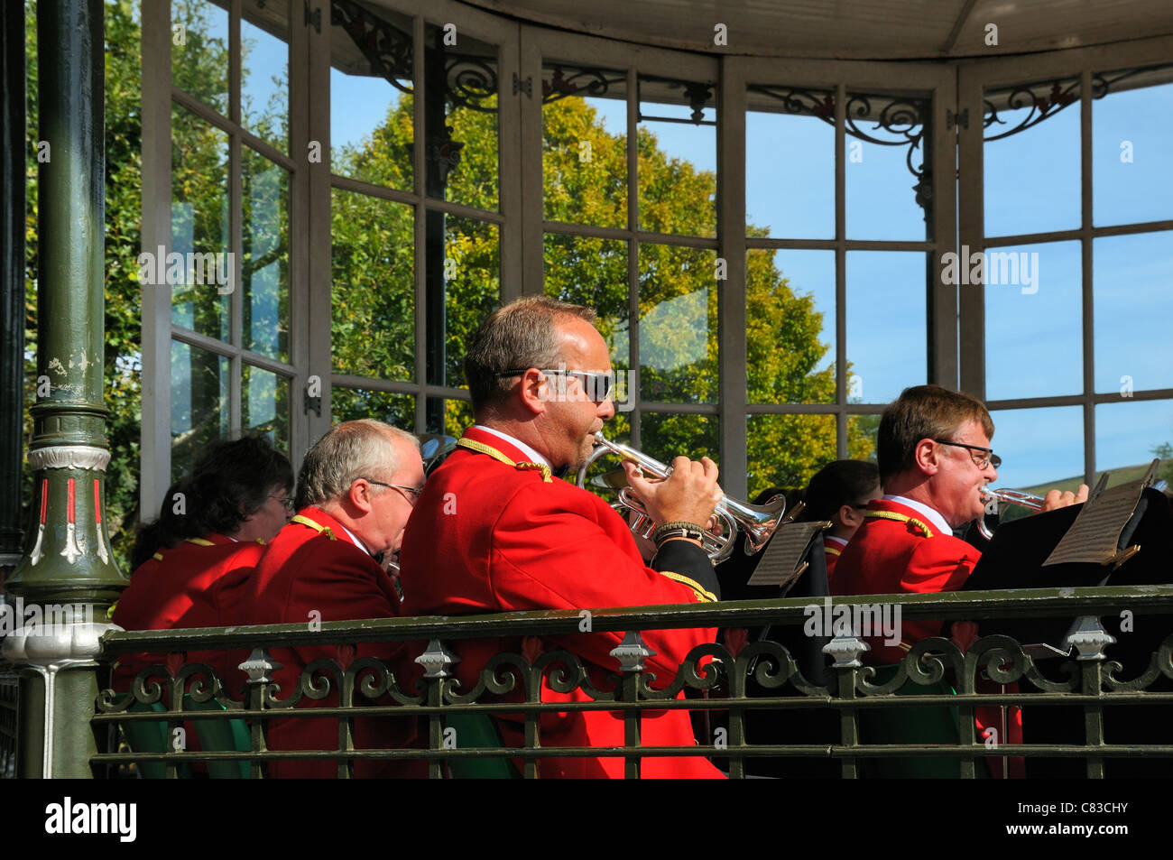 Brass band performing in Dartmouth bandstand, Devon, UK - Stock Image
