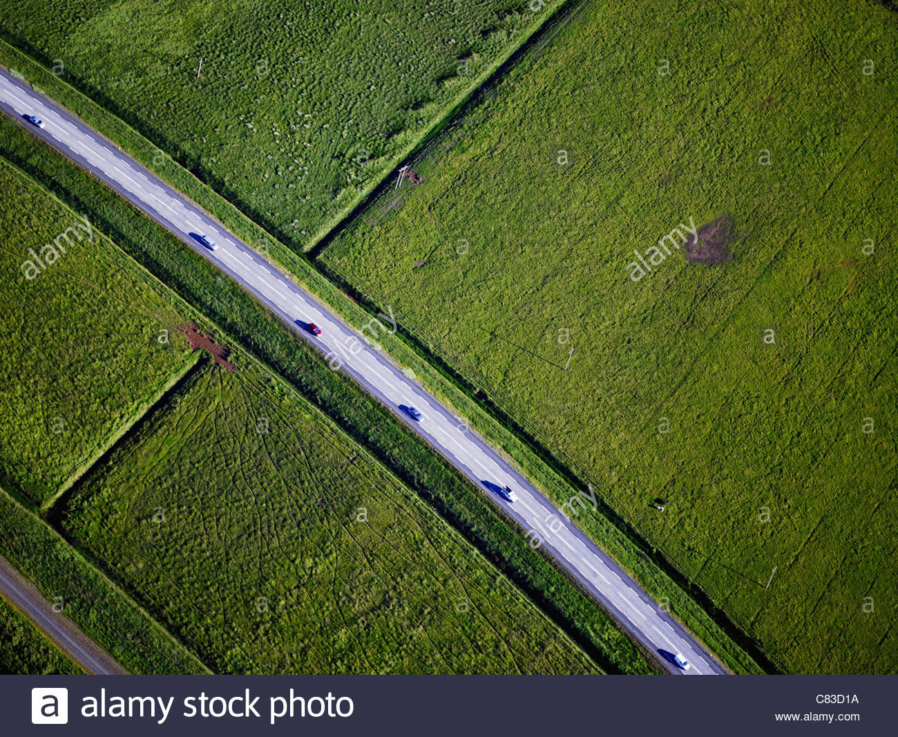 Paved road through rural landscape - Stock Image