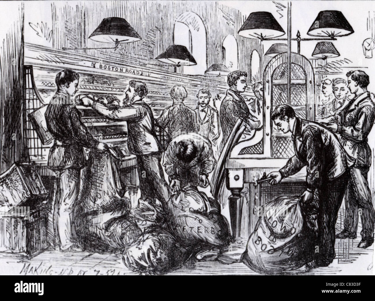 GENERAL POST OFFICE at St Martins-le-Grand in 1875. Workers sorting mail into sacks for provincial delivery by train Stock Photo