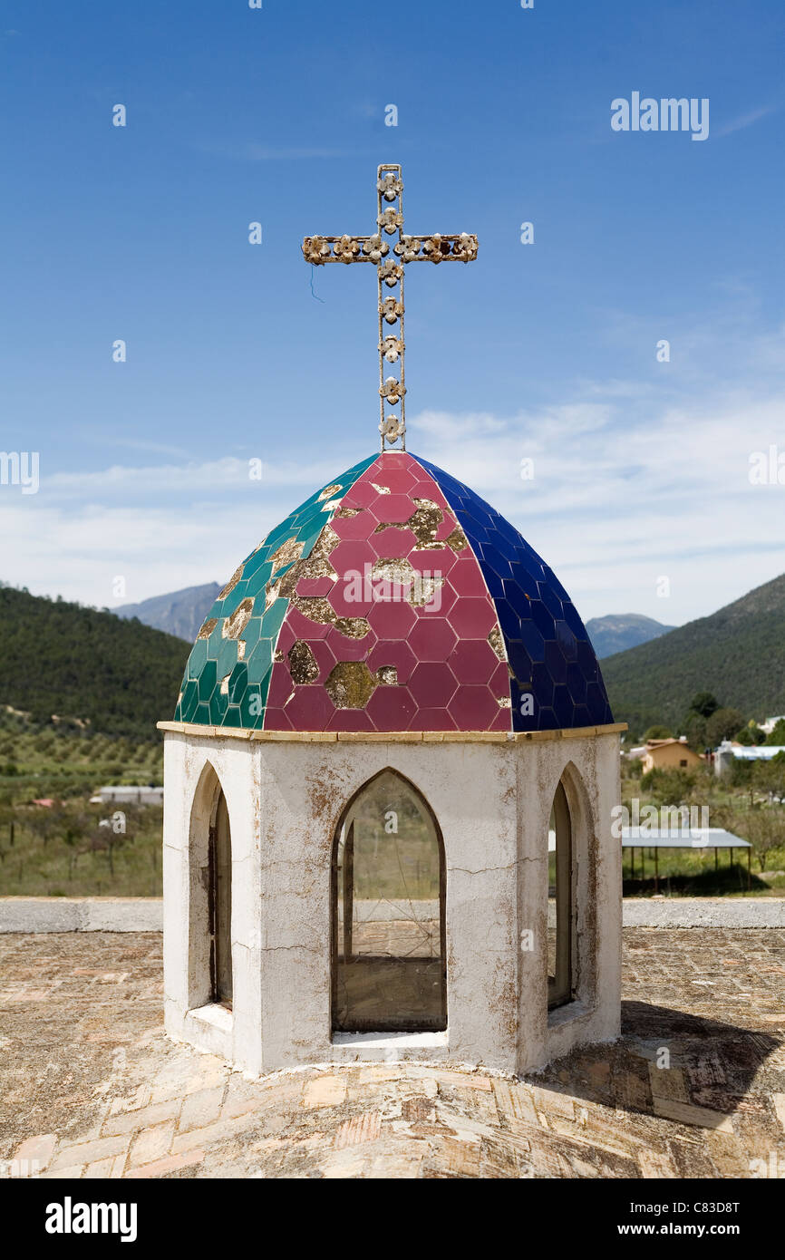 A church spire in the village of Los Lirios in the Arteaga National Park, Mexico. - Stock Image