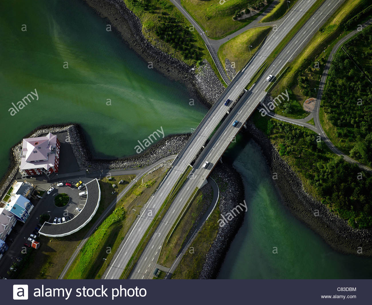 Aerial view of paved bridge over river - Stock Image